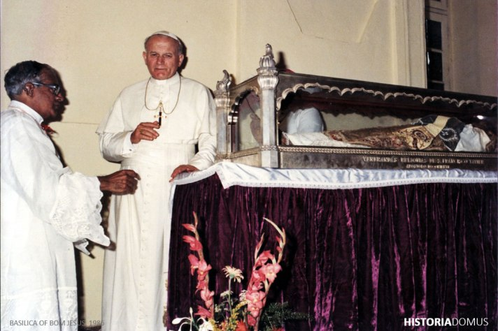 Fr. Vasco do Rego SJ accompanies Pope John Paul II as His Holiness pays his respects to St. Francis Xavier at Basilica of Bom Jesus, Old Goa